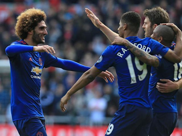 Fellaini celebrates with teammates after scoring the opening goal (Getty)