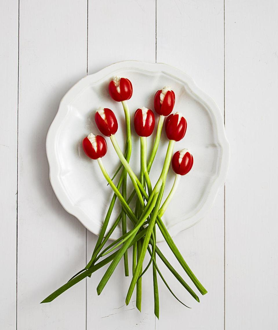 """<p>These pretty appetizers practically spring into bloom, and they're so easy to assemble. Just don't forget to tell your guests about the hidden toothpick!</p><p><a href=""""https://www.goodhousekeeping.com/food-recipes/dessert/g3303/how-to-make-your-food-look-like-flowers/?slide=1"""" rel=""""nofollow noopener"""" target=""""_blank"""" data-ylk=""""slk:Get the recipe for Tomato Tulips »"""" class=""""link rapid-noclick-resp""""><em>Get the recipe for Tomato Tulips »</em></a><br></p>"""