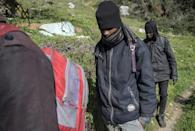 African migrants are pictured in the Belyounech forest, a few kilometres from Ceuta on Morocco's northern coast, in January