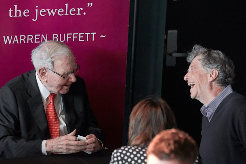 Warren Buffett, Chairman and CEO of Berkshire Hathaway, left, jokes with Gill Gates, right, during a game of bridge following the annual Berkshire Hathaway shareholders meeting in Omaha, Neb., Sunday, May 5, 2019. (AP Photo/Nati Harnik)