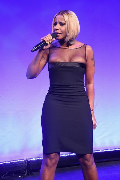 """A longtime supporter of the charity (she also performed at their Cannes event), Mary J. Blige headlined the event. Wearing a form-fitting LBD with illusion neckline, the artist sang her hit """"Real Love,"""" which got the audience up dancing."""