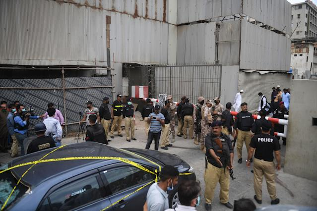 Security personnel guard the main entrance of the Pakistan Stock Exchange building in Karachi on June 29, 2020. - Gunmen attacked the Pakistan Stock Exchange in Karachi on June 29, with four of the assailants killed, police said. (Photo by Asif HASSAN / AFP) (Photo by ASIF HASSAN/AFP via Getty Images)
