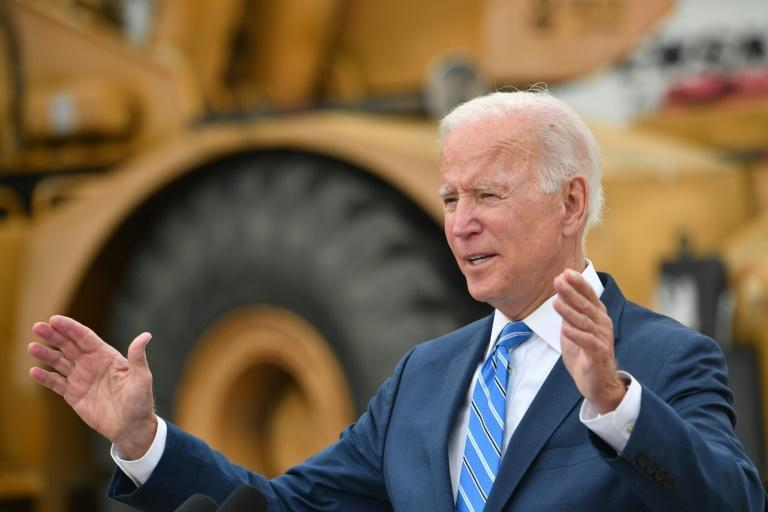 President Joe Biden says Congress must pass his spending plans to keep the US competitive in the world (AFP/Nicholas Kamm)