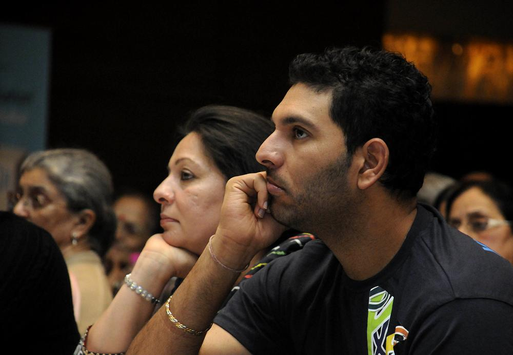 GURGAON, INDIA - FEBRUARY 4: Cricketer and cancer survivor Yuvraj Singh and his mother Shabnam Singh in a Cancer survivor program on World Cancer Day on February 4, 2013 in Gurgaon, India. (Photo by Parveen Kumar/Hindustan Times)