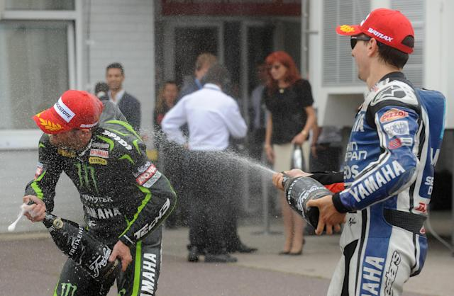 Spanish Moto GP rider Jorge Lorenzo (R) sprays champagne at Yamaha's rider Cal Clutchrow of Great Britain after the Moto GP race at Czech Republic's Grand Prix on August 26, 2012 in Brno. Pedrosa won this race ahead of Jorge Lorenzo and Cal Clutchrow. AFP PHOTO/ MICHAL CIZEKMICHAL CIZEK/AFP/GettyImages