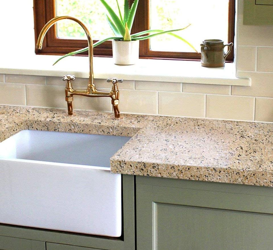 """Give your countertops a beautiful granite look that'll make your space feel super chic and modern. You won't have to spend a fortune to basically replace your countertops.<br /><br /><strong>Promising review:</strong>""""I found out about this kit a few weeks ago. I redid my mother's countertops first and was so pleased with the results, I bought a second kit and did mine this weekend. I am not a crafty person, so if I can do it, anyone can. Just be sure you follow the step-by-step instructions on the included DVD. They came out great!"""" —<a href=""""https://amzn.to/3e9slzZ"""" target=""""_blank"""" rel=""""nofollow noopener noreferrer"""" data-skimlinks-tracking=""""5723569"""" data-vars-affiliate=""""Amazon"""" data-vars-href=""""https://www.amazon.com/gp/customer-reviews/R1DC53367Q6ZL0?tag=bfjasmin-20&ascsubtag=5723569%2C13%2C31%2Cmobile_web%2C0%2C0%2C14870774"""" data-vars-keywords=""""cleaning,fast fashion"""" data-vars-link-id=""""14870774"""" data-vars-price="""""""" data-vars-product-id=""""15955948"""" data-vars-retailers=""""Amazon"""">Sarah W. Fallon</a><br /><br /><strong>Get it from Amazon for <a href=""""https://amzn.to/3glZET9"""" target=""""_blank"""" rel=""""noopener noreferrer"""">$79+</a> (available in three colors).</strong>"""