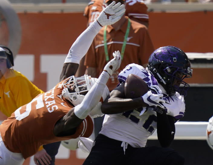 TCU wide receiver Blair Conwright (22) pulls in a pass over Texas defensive back D'Shawn Jamison (5) during the second half of an NCAA college football game, Saturday, Oct. 3, 2020, in Austin, Texas. (AP Photo/Eric Gay)
