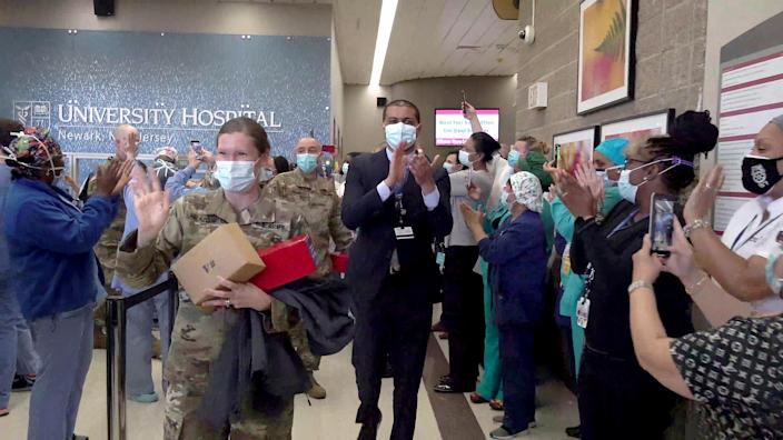 Dr. Shereef Elnahal and staff at University Hospital in Newark, saying goodbye to the U.S. Army health care workers who helped with patient load during the peak of the pandemic in May. (University Hospital Newark)