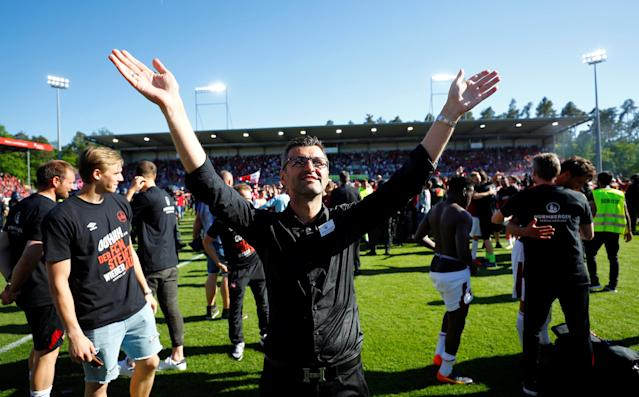 Soccer Football - 2. Bundesliga - SV Sandhausen v Nuremberg - BWT-Stadion am Hardtwald, Sandhausen, Germany - May 6, 2018 Nuremberg coach Michael Kollner celebrates promotion after the match REUTERS/Kai Pfaffenbach DFL RULES TO LIMIT THE ONLINE USAGE DURING MATCH TIME TO 15 PICTURES PER GAME. IMAGE SEQUENCES TO SIMULATE VIDEO IS NOT ALLOWED AT ANY TIME. FOR FURTHER QUERIES PLEASE CONTACT DFL DIRECTLY AT + 49 69 650050