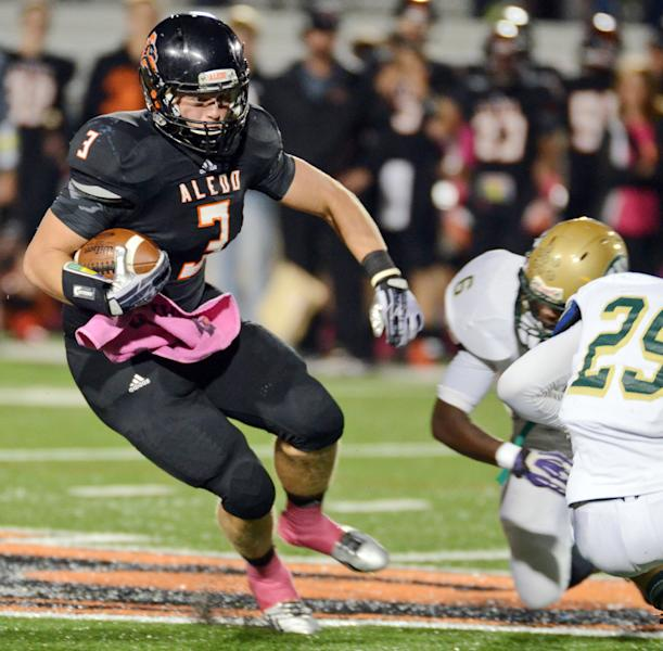 In this Oct. 18, 2013, photo, Aledo's Daythan Davis, left, runs past Western Hills Jacoby Powell (6) , and Desmond Mize as he races for a first down in the first quarter of a football game in Aledo, Texas. Aledo defeated Western Hills 91-0. A parent at Western Hills high school has filed a bullying complaint against the winning coach. (AP Photo/The Fort Worth Star-Telegram, Bob Haynes) MAGS OUT; (FORT WORTH WEEKLY, 360 WEST)