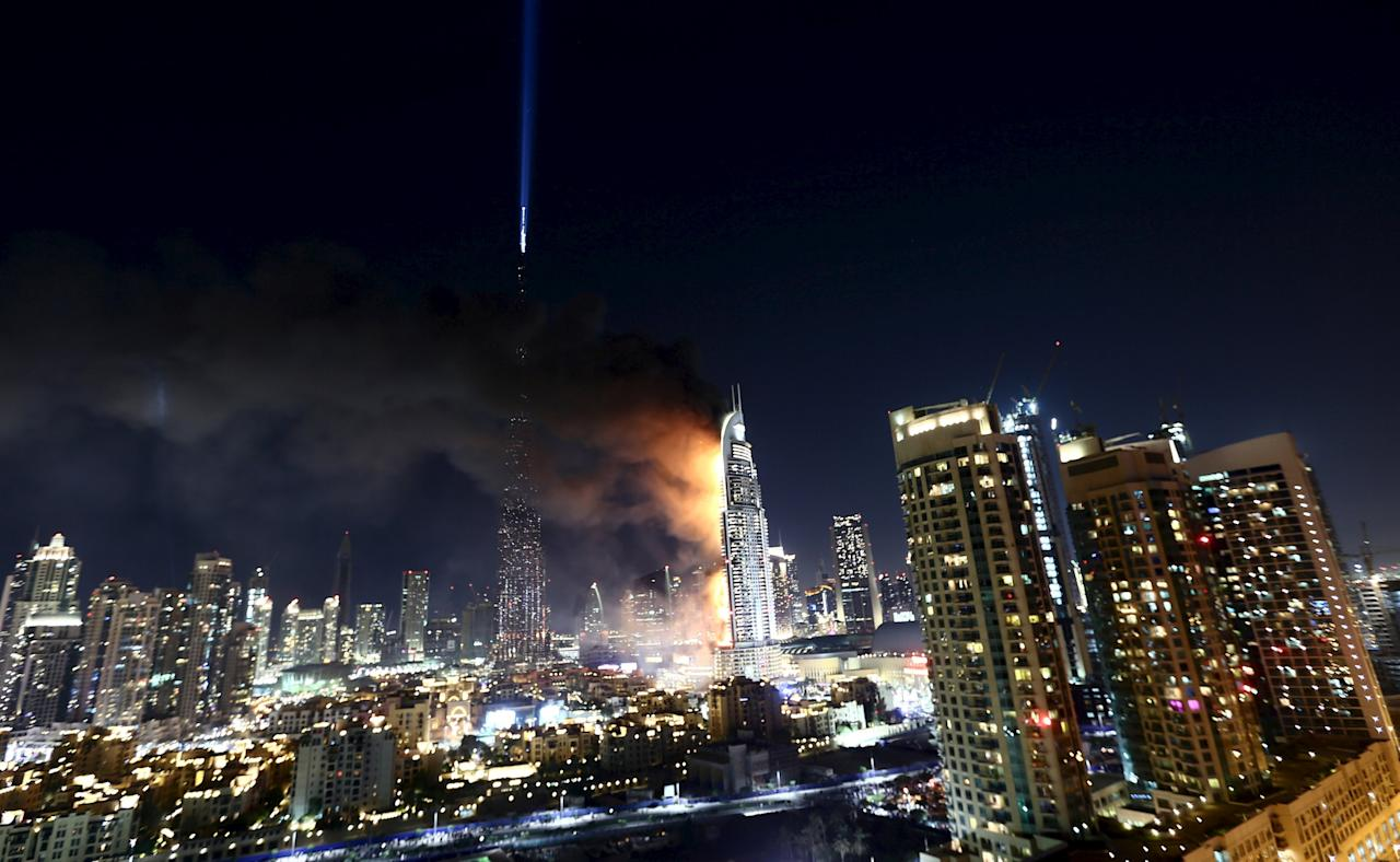 The Address Downtown Dubai hotel and residential block is seen engulfed by fire near the Burj Khalifa, the tallest building in the world, before the New Year celebrations in Dubai December 31, 2015. REUTERS/Hassan Al Rasi        EDITORIAL USE ONLY. NO RESALES. NO ARCHIVE