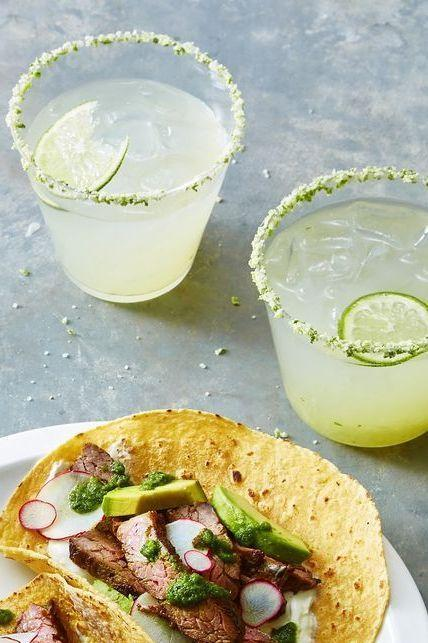 """<p>This classic margarita recipe doesn't require a shaker — which means you can focus on the game, not the bar. </p><p><em><a href=""""https://www.goodhousekeeping.com/food-recipes/party-ideas/a28709164/classic-margarita-recipe/"""" rel=""""nofollow noopener"""" target=""""_blank"""" data-ylk=""""slk:Get the recipe for Fresh Lime Margarita »"""" class=""""link rapid-noclick-resp"""">Get the recipe for Fresh Lime Margarita »</a></em></p>"""