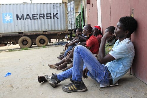 "<span class=""caption"">Unemployed Liberian young men seeking daily jobs at the industrial district of Bushrod Island, Monrovia, Liberia. </span> <span class=""attribution""><span class=""source"">EFE-EPA/Ahmed Jallanzo</span></span>"