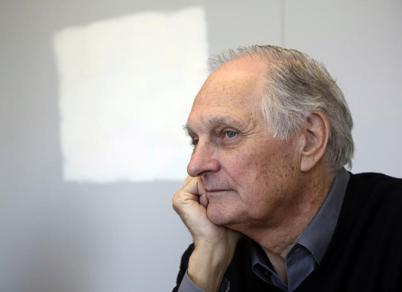 In this Friday, April 26, 2013 photo, actor Alan Alda listens during an interview at Stony Brook University, on New York's Long Island. The film and television star is trying to encourage scientists of all disciplines to ditch the jargon and speak in plain English. (AP Photo/Richard Drew)