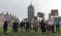 Hospitality workers protest in Parliament Square in London, Monday, Oct. 19, 2020. Hospitality workers are demonstrating outside Parliament against tougher coronavirus restrictions and the amount of financial support given by the government to the industry.(AP Photo/Frank Augstein)