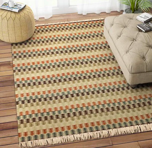 "<a href=""https://fave.co/2ILg6KA"" rel=""nofollow noopener"" target=""_blank"" data-ylk=""slk:BUY HERE"" class=""link rapid-noclick-resp"">BUY HERE</a> Beige Kilim hand woven 8x5 feet wool dhurrie, from Pepperfry, for a discounted price of Rs. 9,699"