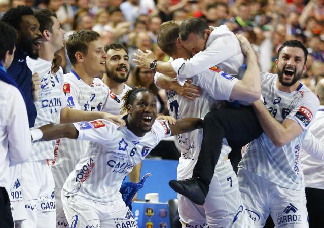 Handball - Men's EHF Champions League Final - HBC Nantes vs Montpellier HB - Lanxess Arena, Cologne, Germany - May 27, 2018. Montpellier HB coach Patrice Canayer celebrates with his players winning the match. REUTERS/Thilo Schmuelgen