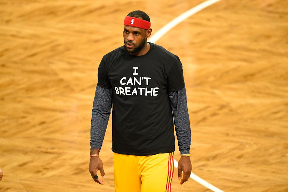 December 8, 2014: Cleveland Cavaliers forward LeBron James (23) wears a t shirt to honor Eric Garner during warmups before a NBA game between the Cleveland Cavaliers and the Brooklyn Nets at Barclays Center in Brooklyn, NY The Cleveland Cavaliers defeated the Brooklyn Nets 110-88. (Photo by Rich Kane/Icon Sportswire/Corbis/Icon Sportswire via Getty Images)