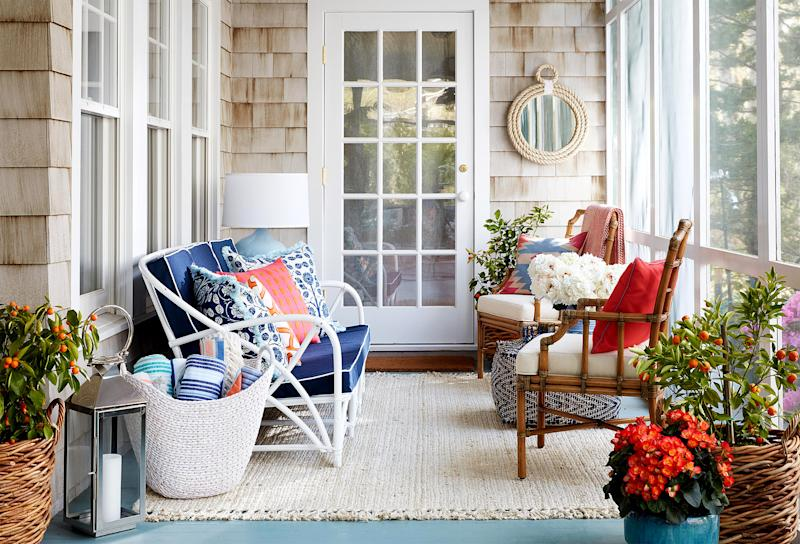 cottage-style porch with patriotic colors