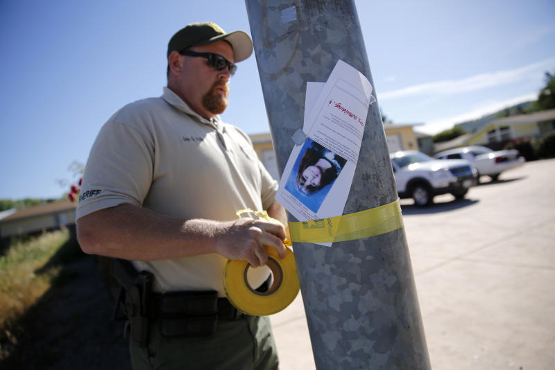 Lake County Sheriff's Deputy G. Wells tapes off an area around a house on Highlands Harbor Drive during the search for missing 9-year-old autistic girl Mikaela Renee Lynch on Monday, May 13, 2013 in Clearlake, Calif. A dive team found Mikaela's body in a muddy creek. The phenomenon of bolting affects large numbers of children with autism, researchers say. And the deaths - 60 in the past four years - are prompting new efforts to raise awareness and find more effective preventive measures. (AP Photo/The Press Democrat, Beth Schlanker)