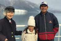 """This July 2019 photo provided by Miguel Gonzalez, shows Margrit and Lucio Gonzalez with their granddaughter, Caylie Gonzalez, in Alaska. They are suing Princess Cruises and owner Carnival Corp. for negligence and wrongful death — one of dozens of lawsuits by passengers and surviving relatives. Lucio Gonzalez died of coronavirus.""""They put him on a ventilator for three weeks and two days, and after that he died,"""" his widow said. """"I never saw him alive again."""" (Miguel Gonzalez via AP)"""