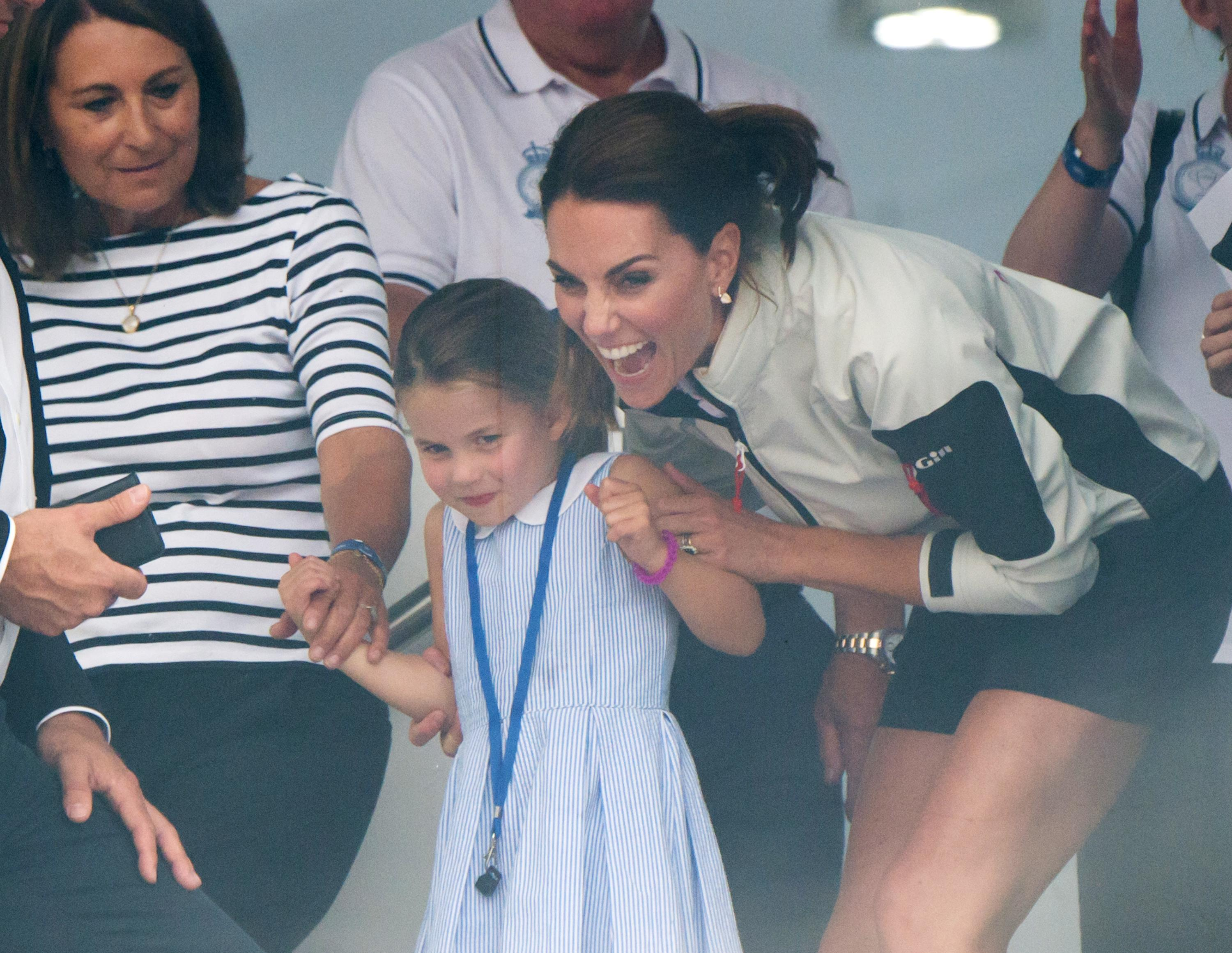 COWES, ENGLAND - AUGUST 08: Carole Middleton, Princess Charlotte and Catherine, Duchess of Cambridge attend the presentation following the King's Cup Regatta on August 08, 2019 in Cowes, England. (Photo by Samir Hussein/WireImage)
