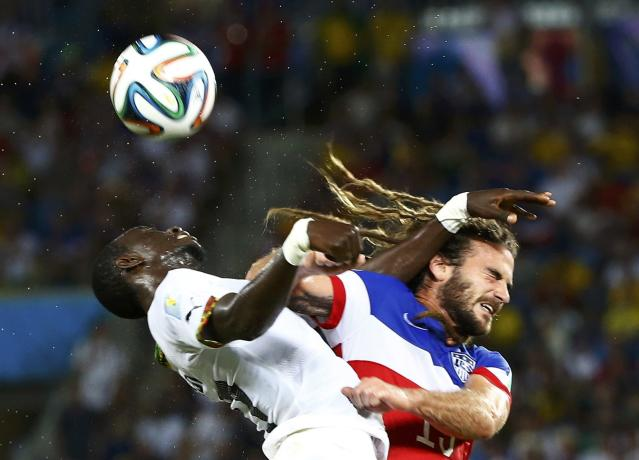 Kyle Beckerman of the U.S. is fouled by Ghana's Mohammed Rabiu during their 2014 World Cup Group G soccer match at the Dunas arena in Natal June 16, 2014. REUTERS/Stefano Rellandini (BRAZIL - Tags: TPX IMAGES OF THE DAY SOCCER SPORT WORLD CUP)