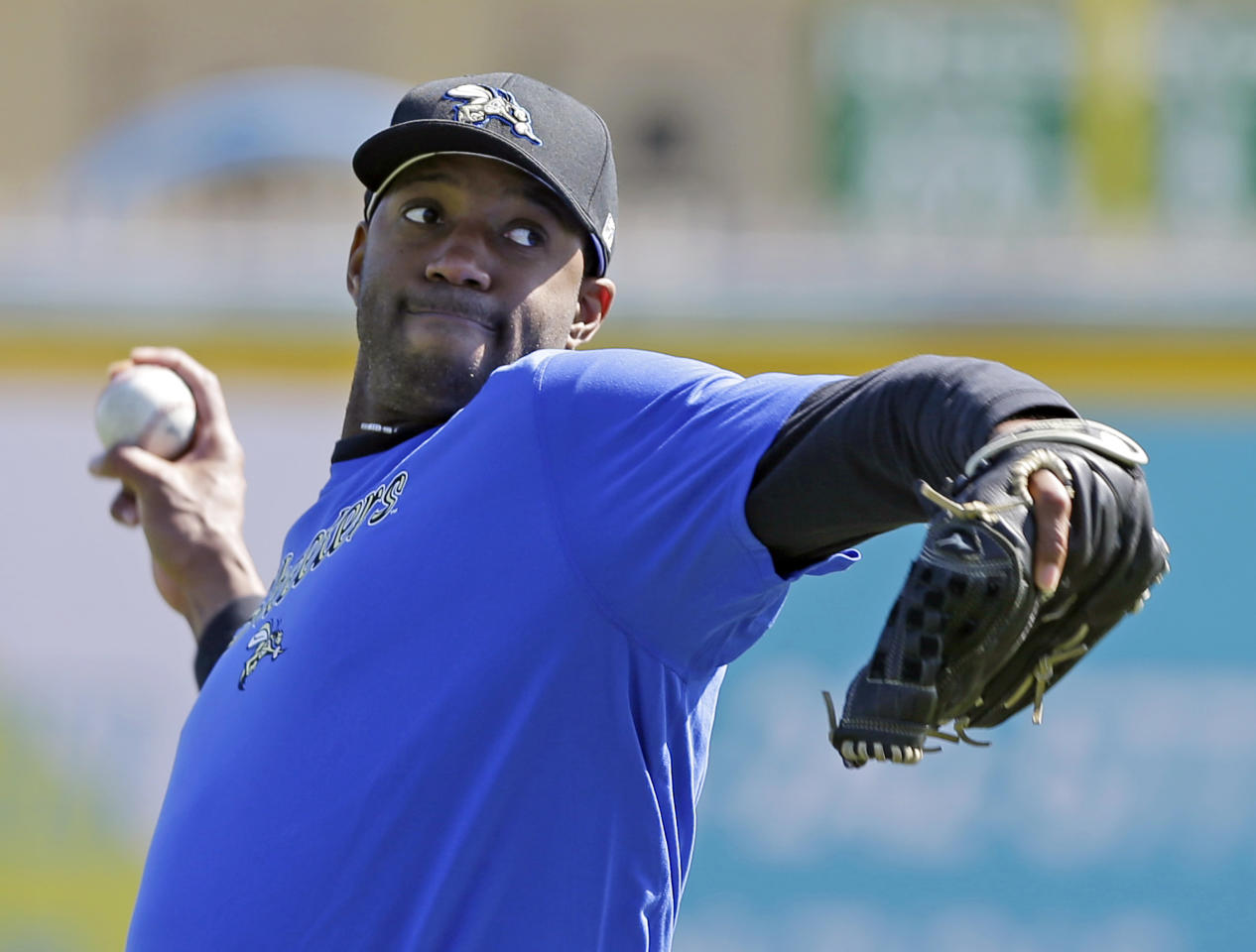 Retired NBA All-Star Tracy McGrady throws a pitch at the Sugar Land Skeeters baseball stadium Wednesday, Feb. 12, 2014, in Sugar Land, Texas. McGrady hopes to tryout as a pitcher for the independent Atlantic League Skeeters. (AP Photo/Pat Sullivan)
