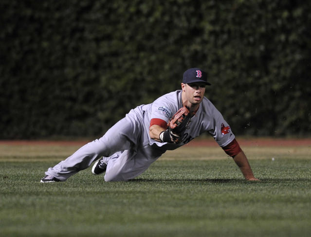 CHICAGO, IL - JUNE 16: Daniel Nava #66 of the Boston Red Sox makes a diving catch in the eighth inning against the Chicago Cubs on June 16, 2012 at Wrigley Field in Chicago, Illinois. (Photo by David Banks/Getty Images)