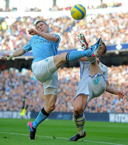 Leeds United's English defender Stephen Warnock (R) vies with Manchester City's English midfielder James Milner during the fifth round English FA Cup football match between Manchester City and Leeds United at the Etihad Stadium in Manchester on February 17, 2013. City won 4-0