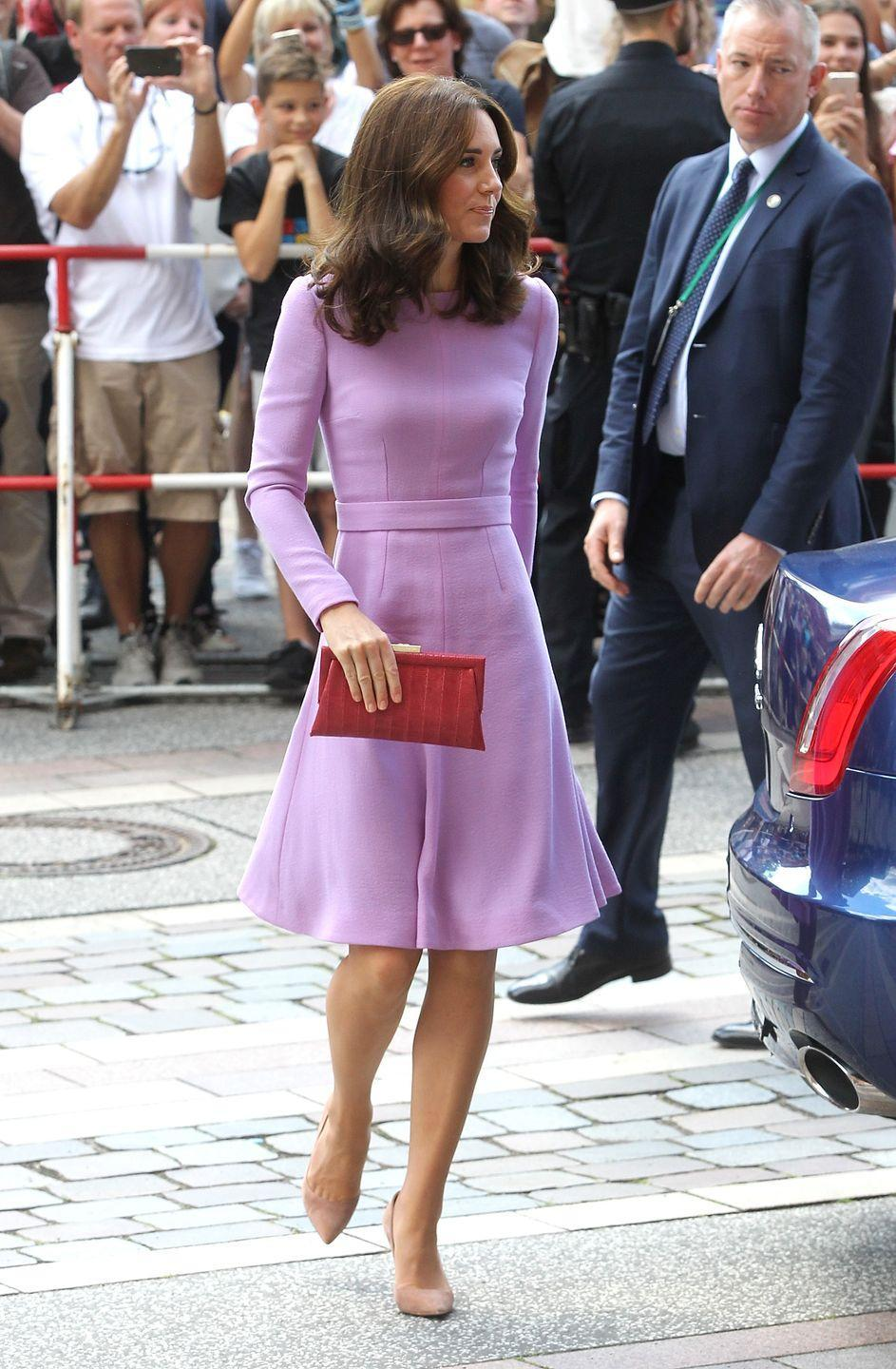 <p>In July the previous year Kate wore the same dress with the same shoes and bouncy blow dry, but opted for a different bag.</p>