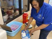 Roanya Rice, public health director, Central District Health Department prepares COVID-19 vaccines in Shelbyville, Ky., on Friday, June 18, 2021. With the U.S. falling short of President Joe Biden's goal of having 70% of all American adults at least partially vaccinated by the Fourth of July, public health officials in places like Spencer County, have shifted the emphasis. (AP Photo/Dylan Lovan)
