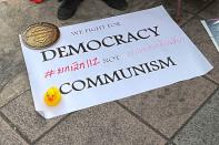 """A message reading """"We fight for Democracy not Communism"""" is pictured during a protest demanding reforms on the monarchy in Bangkok"""