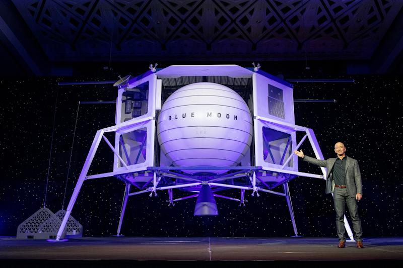 Jeff Bezos gesturing to model of Blue Moon moon lander