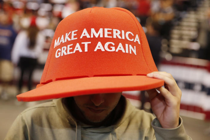 A supporter wears a large hat before a President Donald Trump's rally on Tuesday, Nov. 26, 2019, in Sunrise, Fla. (AP Photo/Brynn Anderson)