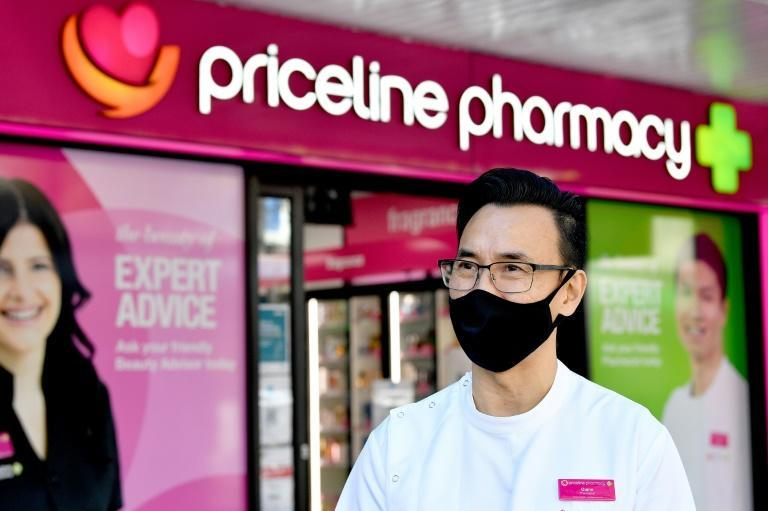 Chemist Quinn On says misinformation has a powerful pull in Sydney's Chinese and Vietnamese communities, fueling vaccine hesitancy (AFP/Saeed KHAN)