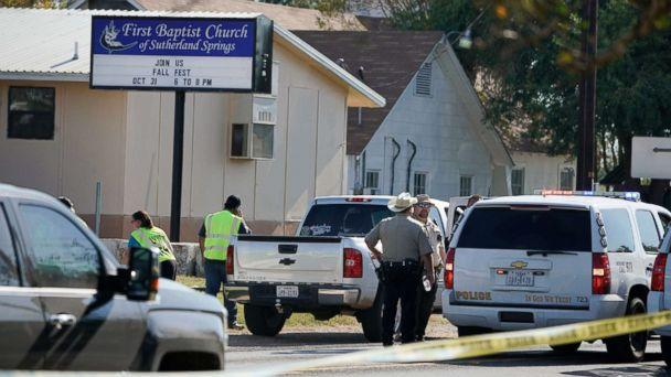 PHOTO: Law enforcement officers gather in front of the First Baptist Church of Sutherland Springs after a fatal shooting, Nov. 5, 2017, in Sutherland Springs, Texas.  (Darren Abate/AP)