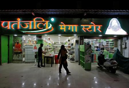 Customers walk outside a Patanjali store in Ahmedabad