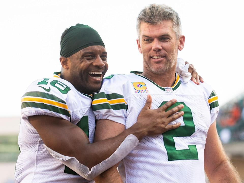 Mason Crosby celebrates with Randall Cobb after kicking a game-winning field goal against the Cincinnati Bengals.