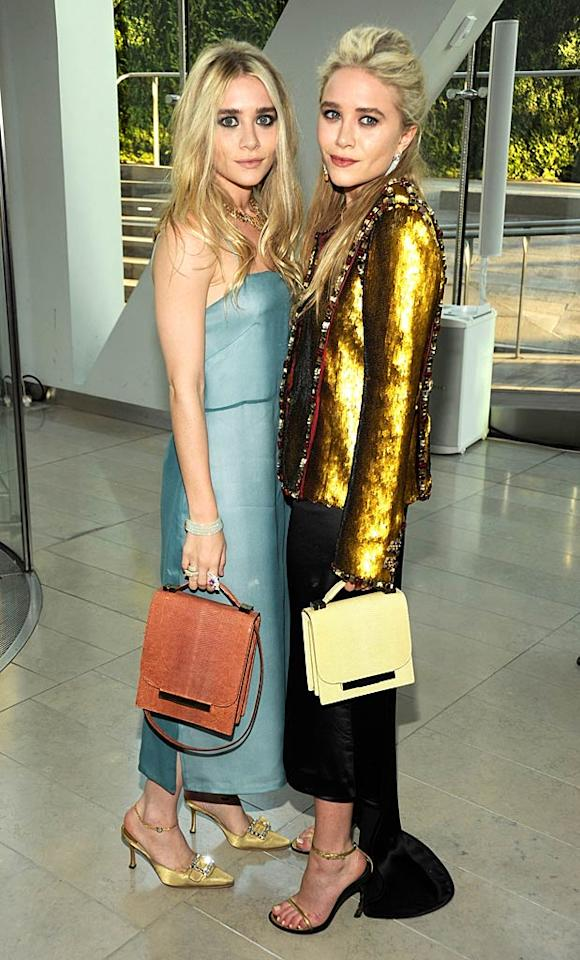 "Twins Ashley and Mary-Kate Olsen have made millions from their fashion lines, so the duo made sure not to miss the big event. Kevin Mazur/<a href=""http://www.wireimage.com"" target=""new"">WireImage.com</a> - June 6, 2011"