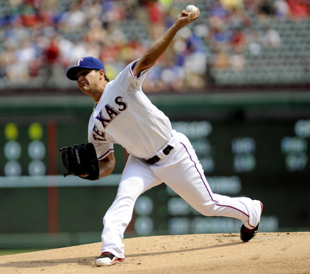 Texas Rangers starting pitcher Martin Perez throws in the first inning of a baseball game against the Oakland Athletics, Sunday, Sept. 15, 2013, in Arlington, Texas. (AP Photo/Matt Strasen)
