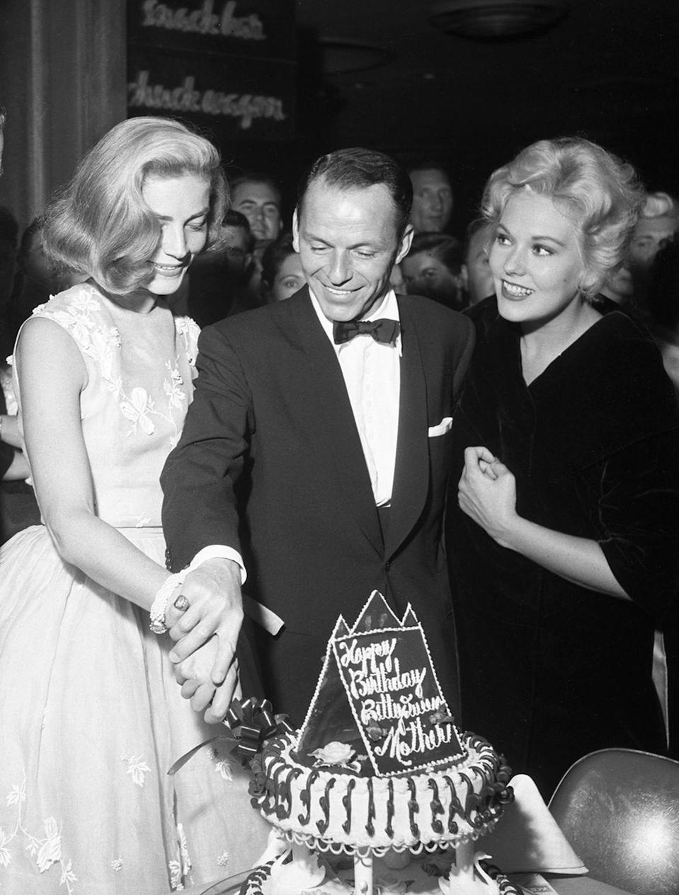 <p>Lauren Bacall, Frank Sinatra, and Kim Novak at the Sands hotel on September 14, 1956. During its heyday, the Sands was the center of entertainment and activity on the Strip.</p>