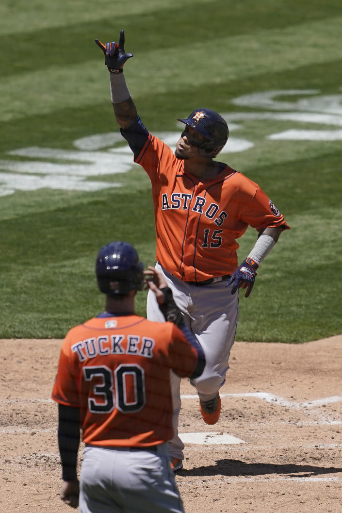 Houston Astros' Martin Maldonado (15) celebrates after hitting a two-run home run that scored Kyle Tucker (30) in the fourth inning of a baseball game against the Oakland Athletics in Oakland, Calif., Thursday, May 20, 2021. (AP Photo/Jeff Chiu)