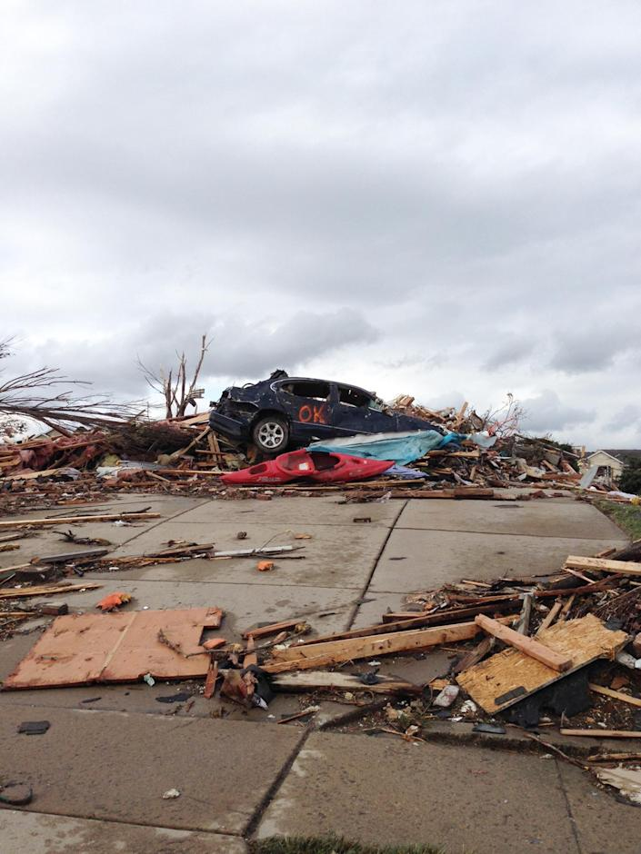 A view of part of Washington, Ill. is seen Sunday, Nov. 17, 2013 after a tornado moved through the area. Intense thunderstorms and tornadoes swept across the Midwest on Sunday, causing extensive damage in several central Illinois communities while sending people to their basements for shelter and even prompting officials at Soldier Field in Chicago to evacuate the stands and delay the Bears game. (AP Photo/Alex Kareotes)