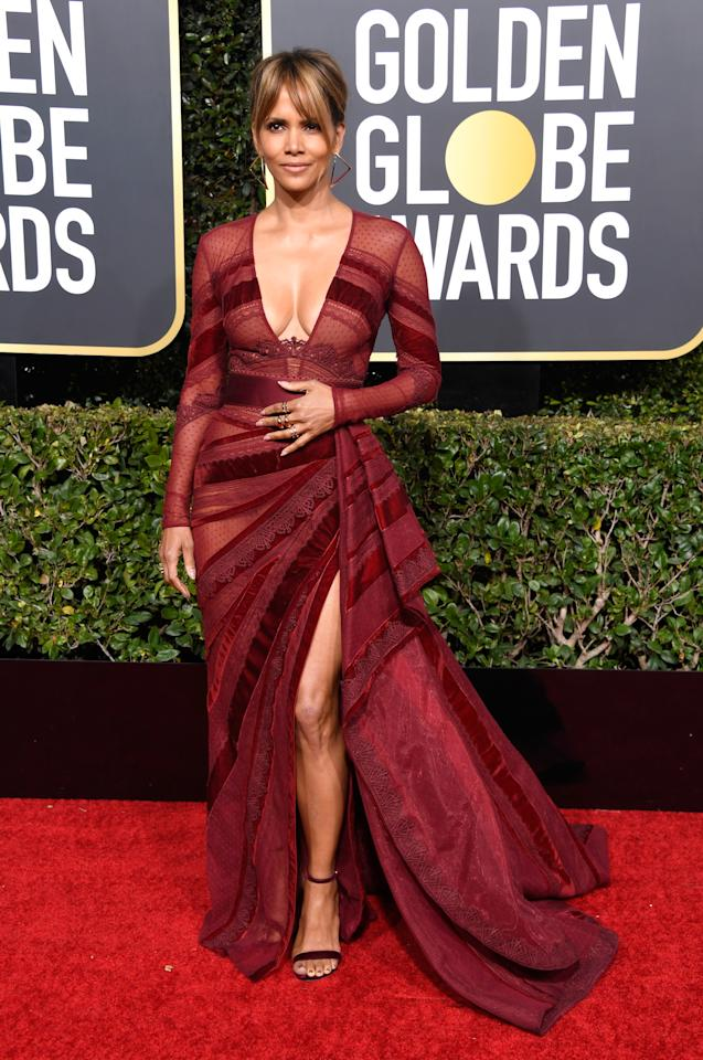 <p>Berry had heads turning in this burgundy gown by Zuhair Murad. Image via Getty Images. </p>