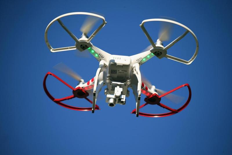 It is the first time a plane has been forced to avoid multiple drones (Getty Images)