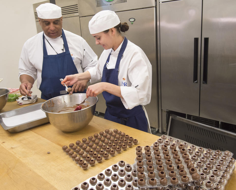 Pastry chef Selwyn Stoby and an assistant prepare some kirsch-filled truffles. (Photo: PA Images)