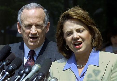 John and Patsy Ramsey address the media after completing two days of police interviews regarding the death of their daughter JonBenet Ramsey at their lawyer's office in Atlanta, Georgia in this August 29, 2000, file photo. REUTERS/Tami Chappell/Files