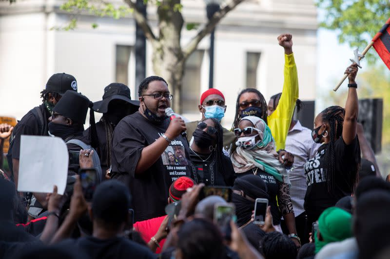 FILE PHOTO: People protest after a Black man identified as Jacob Blake was shot several times by police in Kenosha
