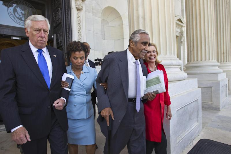 From left, House Minority Whip Steny Hoyer of Md., Rep. Barbara Lee, D-Calif., Rep. Charles Rangel, D-NY, and Rep. Carolyn B. Maloney, D-NY, walk out of the Capitol, arm-in-arm, as members of the Congressional Black Caucus and many House Democrats protest the vote to hold Attorney General Eric Holder in contempt, Thursday, June 28, 2012, on Capitol Hill in Washington. (AP Photo/J. Scott Applewhite)